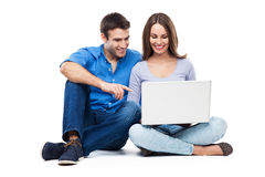 Young couple with laptop computer Royalty Free Stock Photo