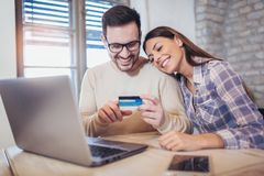 Young couple with Laptop Computer and Credit Card. Buying online Royalty Free Stock Image