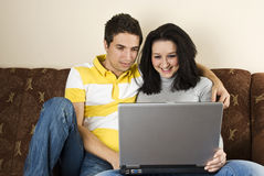 Young couple with laptop home Stock Photo