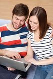 Young couple with a laptop Royalty Free Stock Photography