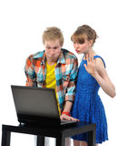 Young couple with laptop Stock Images
