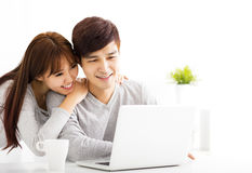 young Couple with Laptop In living room Royalty Free Stock Photo