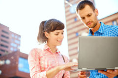 Young couple with laptop Stock Image