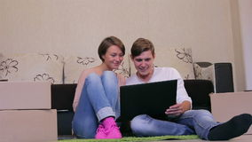 Young couple with a laptop stock footage
