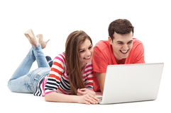 Young couple with laptop. Over white background Royalty Free Stock Photos