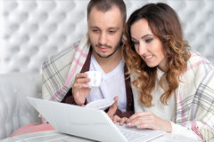 Young couple with laptop. Portrait of happy young couple with laptop at home Royalty Free Stock Photo