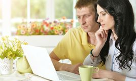 Young couple with laptop. Portrait of happy young couple with laptop at home Stock Photo