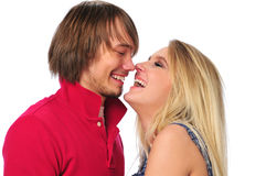 Young couple laughing and looking at each other Stock Images