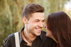 Young couple laughing. Young couple walking in park laughing close-up Stock Photo