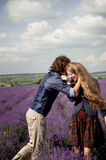 Young couple  in a lavender field. Royalty Free Stock Photos