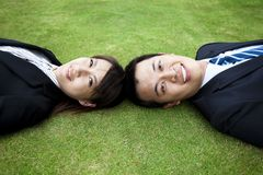 Young couple and lay on the grass Royalty Free Stock Photography