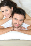 Young couple laying in bed Stock Photos