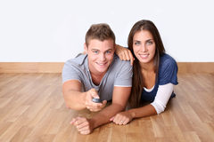 Young couple laying on the floor Royalty Free Stock Photography