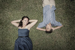 Young couple laying on the grass Royalty Free Stock Photo