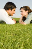 A young couple laying on grass Stock Images