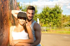 Young Couple leaning against a wall in a urban environment Stock Photography