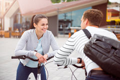 Young couple leaning on the bikes Royalty Free Stock Images