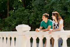 Young couple leaning on a bridge parapet Royalty Free Stock Image