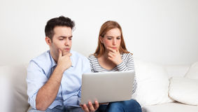 Young couple learning with a notebook Stock Image