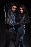 Young couple in leather jackets in a fashion pose Royalty Free Stock Photos