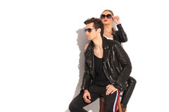 Young couple in leather jackets looking away Stock Photos