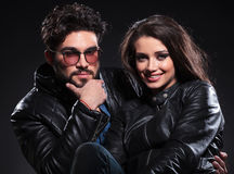 Young couple in leather jackets, pensive man Royalty Free Stock Image