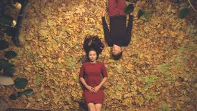 Young couple in leaves
