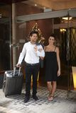 Young couple leaving hotel Stock Image