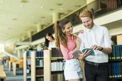 Young couple in the library Stock Photography