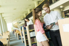 Young couple in the library Royalty Free Stock Images