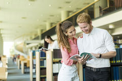 Young couple in the library Royalty Free Stock Photo