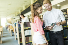 Young couple in the library Stock Image