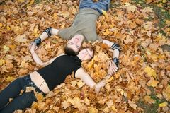 Young  couple lies on leaves Stock Images