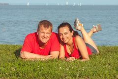 Young couple lies on the shore in lake Balaton in Hungary royalty free stock photos