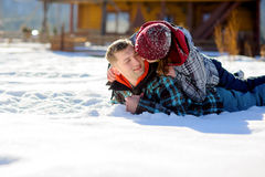 Young couple lies on the snow. Stock Photos