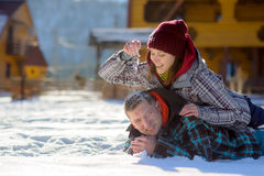 Young couple lies on the snow. Royalty Free Stock Photography