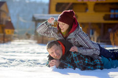 Young couple lies on snow. Stock Images