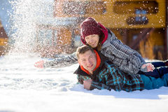 Young couple lies on the snow. Stock Photography