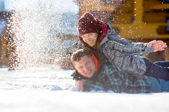 Young couple lies on the snow. Stock Photo
