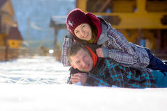 Young couple lies on snow. Stock Image