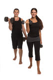 Young Couple Lifting Weights Isolated Royalty Free Stock Images