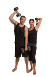 Young Couple Lifting Weights Isolated Royalty Free Stock Photography