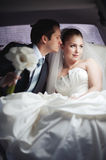 Young couple in limo kissing Stock Image