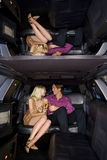 Young couple in limousine, smiling at each other Royalty Free Stock Photos