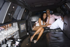 Young couple in limousine, smiling, portrait Royalty Free Stock Photo