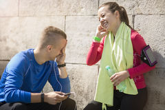 Young couple listening music on earphones Royalty Free Stock Image