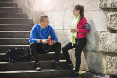 Young couple listening music on earphones. Happy young couple listening to music on the earphones smiling and laughing after jogging Stock Images