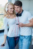 Young Couple Listening Music on Phone So Sweet Royalty Free Stock Photography