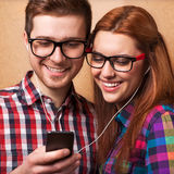 Young couple listening music. Together. Hipster style Stock Photography