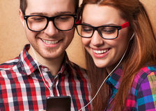 Young couple listening music. Together. Hipster style Royalty Free Stock Photos